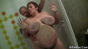 Skinny guy fucks busty plumper in the shower