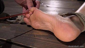 Busty Milf gets feet tormented in bondage