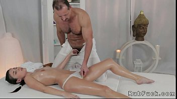 Hot ass brunette gets oil massage on a table