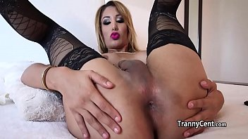 Busty tranny played with red dildo