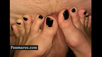 Amateur footjob and handjob ending with cumshot on feet