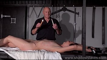 Bondage pictureson table Table tied amateur slave lolanis candle wax bdsm and bondage babe in erotic domination by strict sadomasochist master in the dungeon