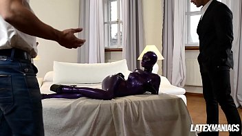 Submissive Latex Lucy spanked, fingered and dominated by two studs