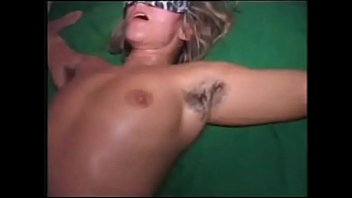 Blonde masked MILF with hairy armpits and pussy
