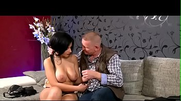 Busty brunette with old man.