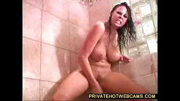 Hot big boobed babe toying around with a giant dildo in the bathroom www.privatehotwebcams.com