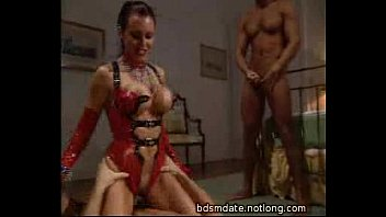 Hot mistress abusing her slaves