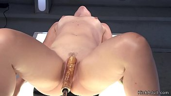 Babe fucks machine and squirts on table