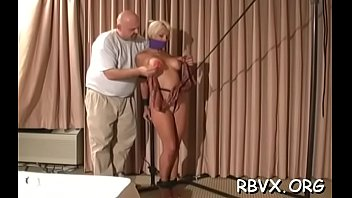 Ballgagged and unable to move, this slut gets stimulated