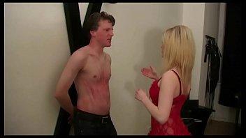 Young Femdom Mistress dominate man in BDSM Studio