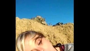 Blonde amateur girl sucking boyfriends huge dick at the beach thumbnail