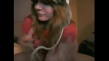 Dorky American Teen In Furry Hat Relaxes On Bed Combocams