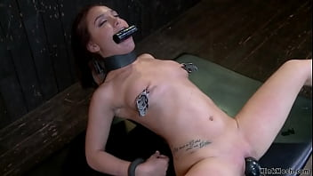 Chained brunette gets anal plugged