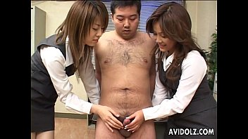 Two naughty Japanese babes munch on a hard dick