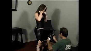 Hot bitch in a leather suit lets a muscular dude lick her legs