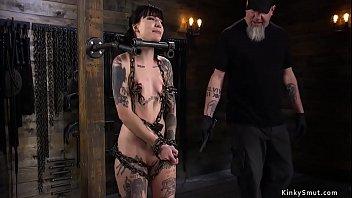 Tattooed petite slave on device bondage