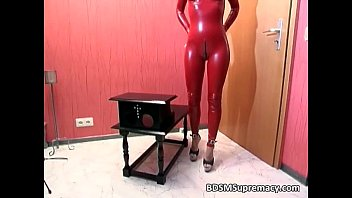 Clothing latex - Nasty babe in red latex cloth gets her