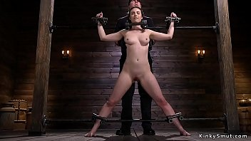 Brunette in spread eagle bondage caned
