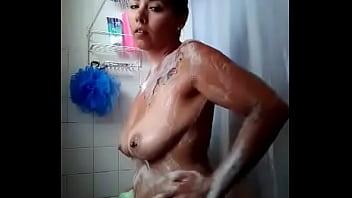 Big nippled mild taking a shower