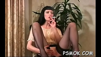Older slut blows a dude while smoking a cigarette