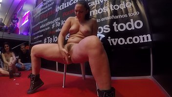 Pamela Sanchez squirts in front of a group of fans in Barcelona Erotic Festival to show how to stimulate her pussy to get a woman ejaculation.