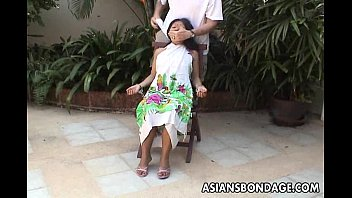 Asian teens tied up - Asian teen tied up and hand cuffed on a chair