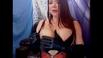 Crossdresser temporary breast implant Big titty camgirl masturbates in long black gloves and boots