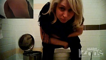 Blonde in blue panties peeing