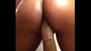 Round black booty riding big dildo