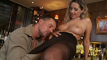 Slutty blonde in stockings fucks horny hunk in a bar