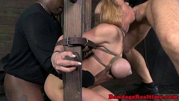 Sub spitroasted on bondage frame