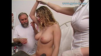 Young girl holds breast - Gyno exam of young busty girl