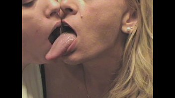 Dogs long tongue licked Pat and her long tongue