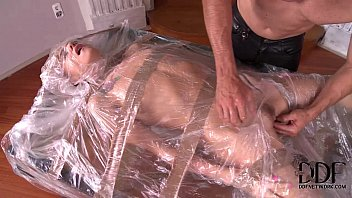 Self bondage in plastic bags - Leyla black bound in plastic gets her mouth asshole used