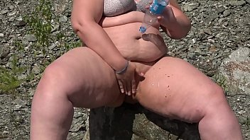 Chubby washes a fat pussy outdoors or at home, an enema in her hairy cunt. Amateur fetish.