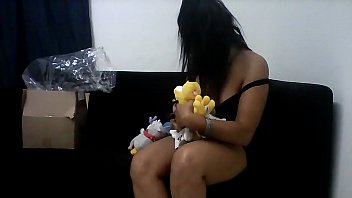 Sarah Rosa Showing Toys That Won From a Fan
