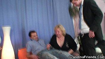 Granny takes two cocks at once thumbnail