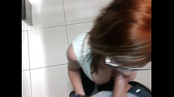 Red head sucking in bathroom stall at school - SleezyCams.com