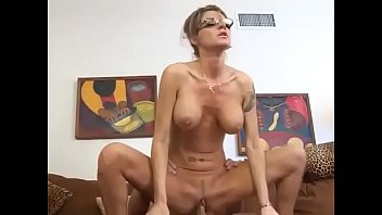 Austere woman with glasses and big tits proves to be a real slut