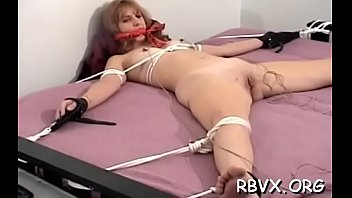 Gal in slutty outfit gets orgasams while being bounded