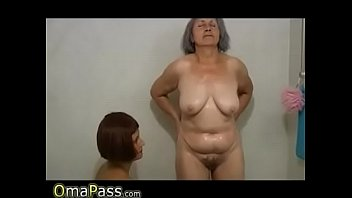 Mature horny hottie takes care of younger girl