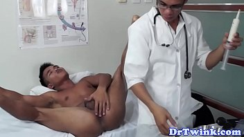 Twink asian md gives enema to patient