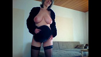 blonde milf rubs her tits pussy ass with fur hat