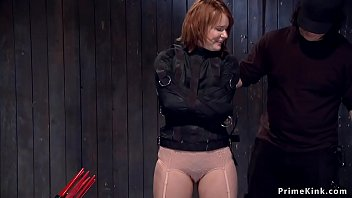 Redhead in strait jacket gets tormented