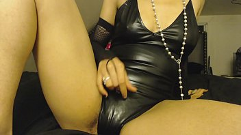 Submissive latex bodysuit Rubbing pussy in latex leather bodysuit, mildly hairy