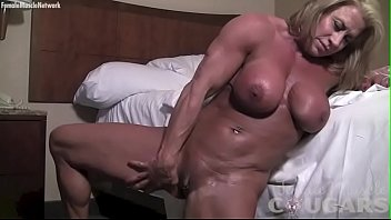 Female Muscle Cougar Rubs Her Big Tits and Pussy