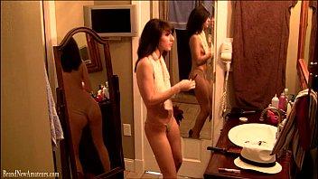 Cute amateur girl dancing in bathroom