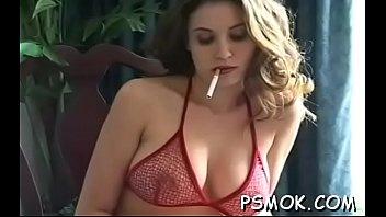 Elegant honey smokes a cig