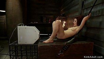 Oiled brunette fucks anal machine