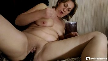 Fat stepmom uses a dildo on her tunnel